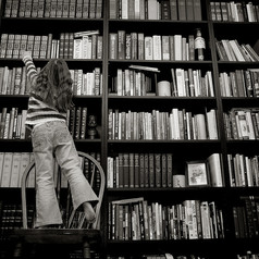 Girl_reaching_for_books